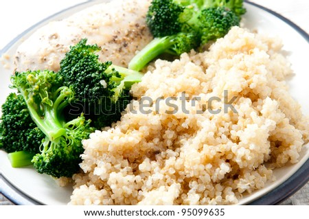 quinoa, an ancient grain with broccoli and roasted chicken breasts. This heart healthy meal is also gluten free - stock photo