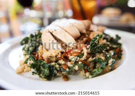 Quinoa and Kale Salad Topped with Sliced Chicken Breast - stock photo
