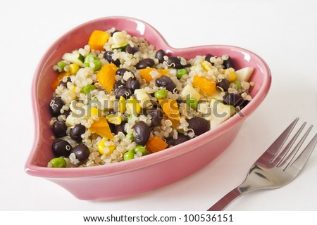 Quinoa and vegetable salad in a heart-shaped dish - stock photo