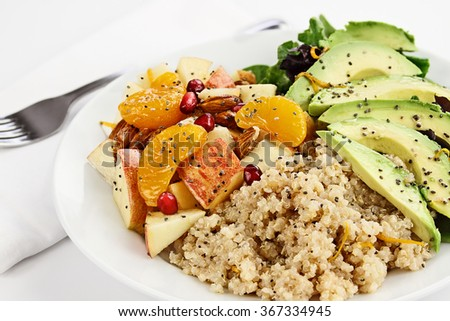 Quinoa, avocado and apple salad. Perfect for the detox diet or just a healthy meal. Selective focus with extreme shallow depth of field.