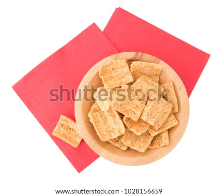 Quinoa crisps, chips isolated on white. Gluten free. Healthy snack, aperitif.