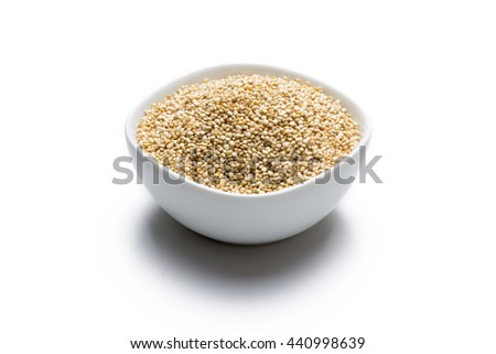 Quinoa in white bowl isolated on white background, frontview. - stock photo