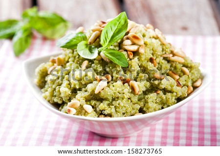 Quinoa meal with pine nuts and fresh basil