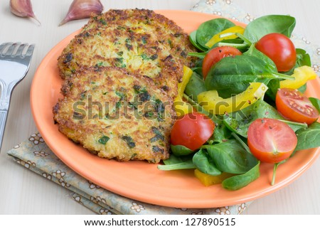 Quinoa pancakes and salad from fresh vegetables - stock photo