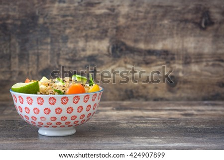 Quinoa salad on a rustic wooden table  - stock photo