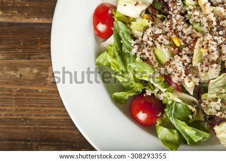 Quinoa salad, vegetarian and diet food - stock photo