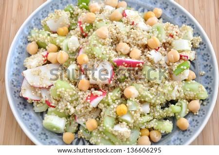 Quinoa Salad with chickpeas, red radish and cucumber - stock photo