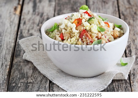 Quinoa salad with vegetables mix, chickpea and cheese.Superfoods concept. - stock photo