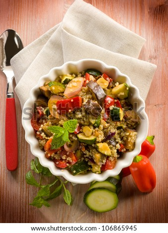 quinoa salad with vegetables, vegetarian food - stock photo