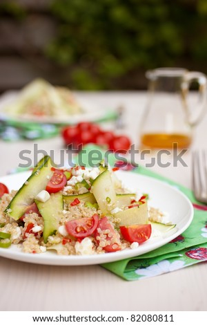 Quinoa, tomatoes, feta and courgette make up a delicious salad - stock photo