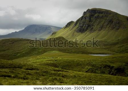 Quiraing mountain on isle of skye, Scotland by a beautiful summer day. - stock photo