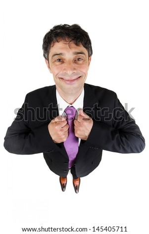 Quirky high angle portrait of an eager to please businessman standing holding his lapels with his hands and looking up giving a beaming smile to the camera isolated on white - stock photo
