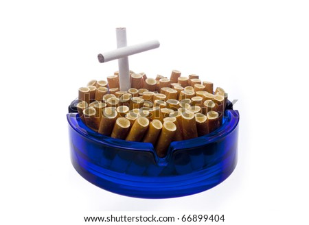 Quit smoking - Ashtray tombstone with cigarette butts and a cross - stock photo
