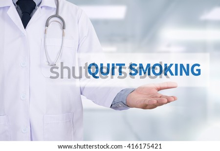 QUIT SMOKING Medicine doctor hand working - stock photo
