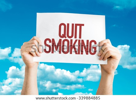 Quit Smoking placard with sky background - stock photo