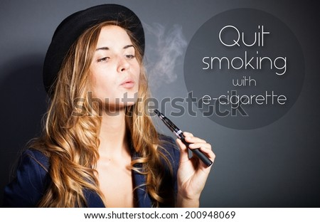 Quit smoking with e-cigarette quote - stock photo