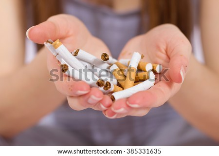 Quit Smoking,woman hands with bunch of breaking cigarette.