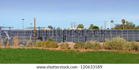 Quite smoke free green electricity from solar panel farm with clean blue Sky as by-product - stock photo