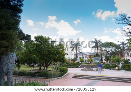 Quito, Ecuador - 28 APRIL, 2015: Unidentified people working in the park to fix all the damaged parts in the park in the valley of Los Chillos