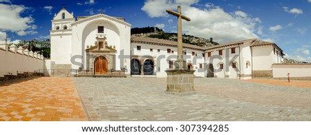 QUITO, ECUADOR- AUGUST 4, 2015: Front view historical church San Diego in old part of Quito showing entire building and beautiful blue sky white clouds shot with, wide angle.