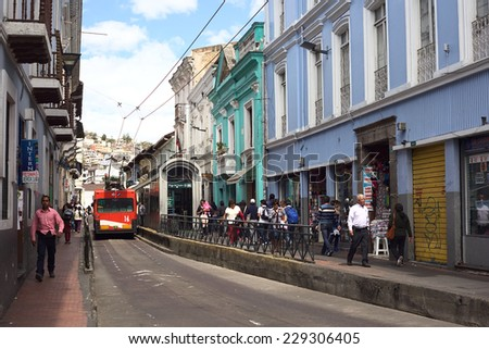 QUITO, ECUADOR - AUGUST 4, 2014: Juan Jose Flores street in the city center at the trolley bus stop Plaza del Teatro on August 4, 2014 in Quito, Ecuador. Quito is UNESCO World Cultural Heritage Site - stock photo