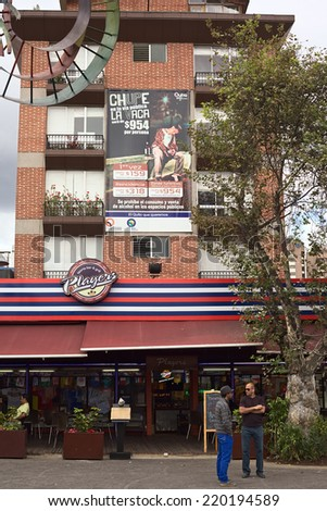 QUITO, ECUADOR - AUGUST 6, 2014: Players Sports Bar and Grill on Plaza Foch in La Mariscal on August 6, 2014 in Quito, Ecuador. The sign informs of a 954 USD fine for drinking in public tourist areas - stock photo
