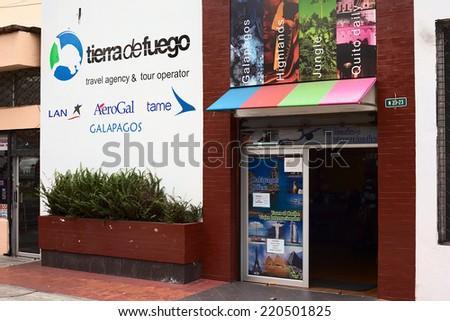 QUITO, ECUADOR - AUGUST 6, 2014: Tierra de Fuego Travel Agency at Amazonas Avenue and Ignacio de Veintimilla Street in the tourist district La Mariscal on August 6, 2014 in Quito, Ecuador - stock photo