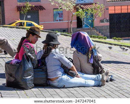 QUITO, ECUADOR - JAN 1, 2015: Unidentified Ecuadorian women in the street. 71,9% of Ecuadorian people belong to the Mestizo ethnic group