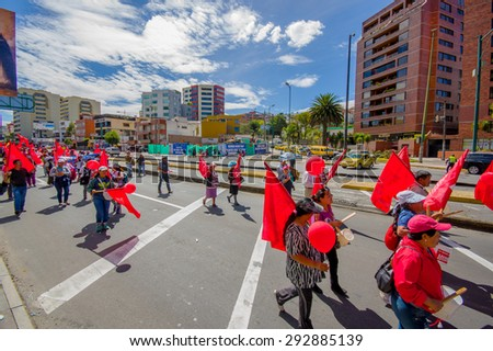 QUITO, ECUADOR - JULY 1, 2015: Supporters of Union Popular party participating by marching and protesting in capital Quito during current anti government demonstrations - stock photo