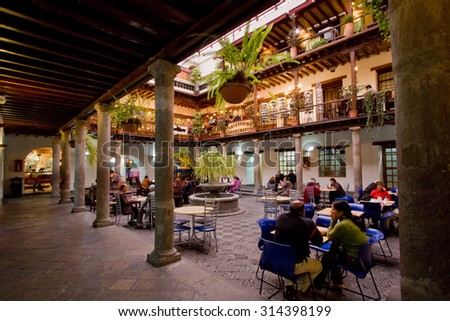 QUITO, ECUADOR - MARCH 3, 2014: Inner court in Archbishop's Palace, with cafes and restaurants, Quito, Ecuador - stock photo