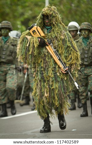 QUITO, ECUADOR- MAY 24 2012 National  military parade, unidentified camouflage  soldier with armo and military gear. May 24, 2012, Quito, Ecuador
