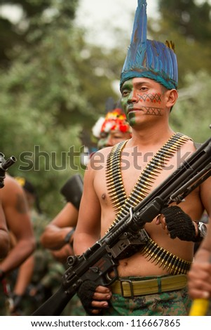 QUITO, ECUADOR- MAY 24 2012 National  military parade, unidentified indigenous amazonic soldier with armo and military gear. May 24, 2012, Quito, Ecuador - stock photo