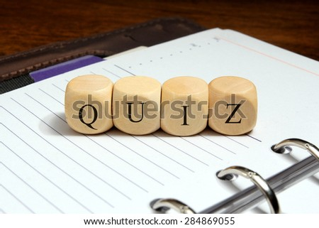 Quiz word concept on notebook