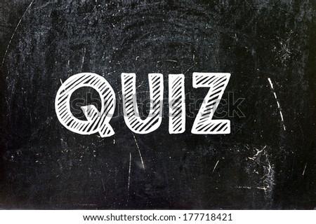 Quiz written with chalk on blackboard education concept - stock photo