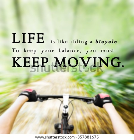 Quote over blurred background: Life is like riding a bicycle. To keep your balance you must keep moving. - stock photo