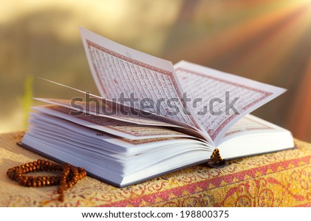 Quran - Holly book of Islam with sunlight - stock photo