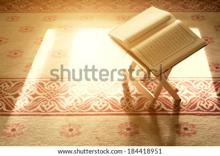 Quran - holy book of Islam in Malaysian mosque  - stock photo