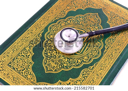 Quran with stethoscope. Concepts of medication and healthcare in islam. No copyrights  - stock photo