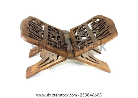 Quran wooden stand before a light background