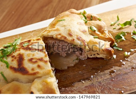 Qutab- baked Chebureki traditional  georgian meat pastry.meat in a pitta bread