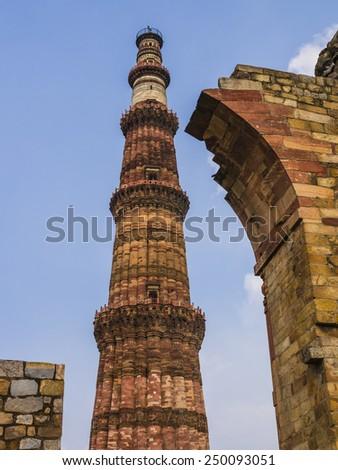 Qutb Minar and surrounding ruins, Mehrauli archeological park, Delhi, India  - stock photo