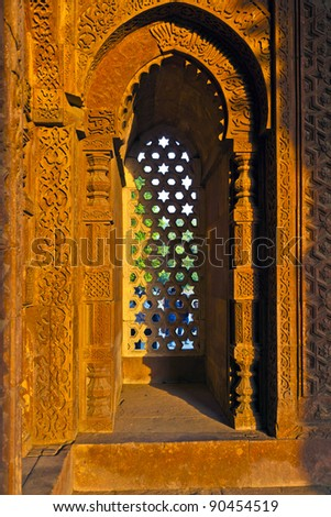 Qutb Minar, Delhi, carvings in the sandstone of a window gives a pattern of sky with stars