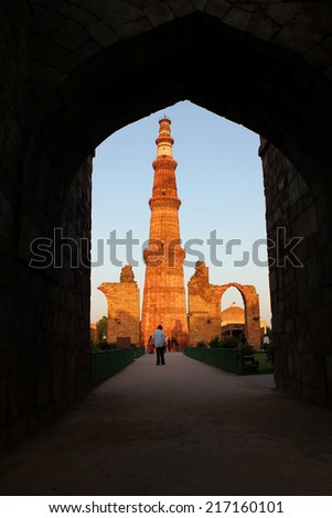 qutub minar from gate - stock photo