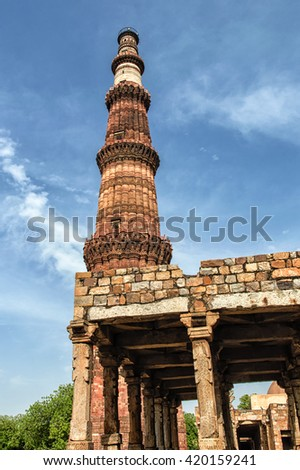 Qutub Minar is a 73 m-high tower of victory, built in 1193 by Qutab-ud-din Aibak immediately after the defeat of Delhi's last Hindu kingdom. Qutub Minar is a UNESCO World Heritage Site. - stock photo