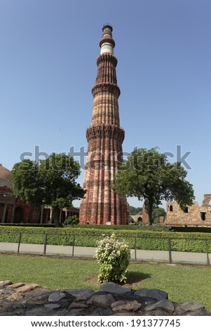 Qutub (Qutab) Minar, the tallest free-standing stone tower in the world, and the tallest minaret in India, constructed with red sandstone and marble in 1199 AD. Unesco World Heritage. India - stock photo