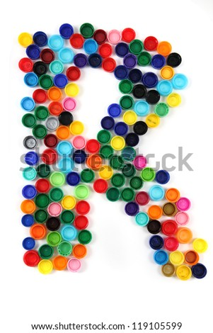 R - alphabet from the plastic caps isolated on the white background
