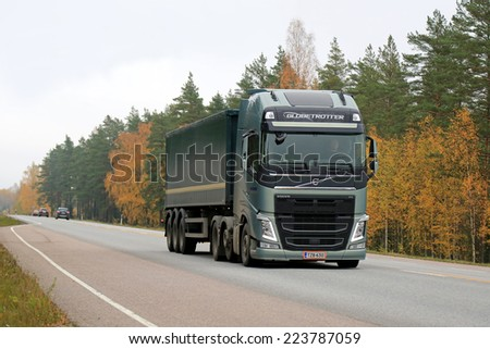 RAASEPORI, FINLAND - OCTOBER 12, 2014: Volvo FH semi truck on the road. Volvo FH has I-Shift Dual Clutch, which enables the driver change gears much faster. - stock photo