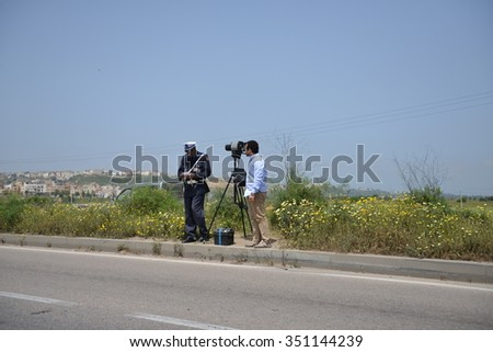 Rabat, Morocco - April 21, 2013: While police officer is taking the report about driver who exceeded the speed limit.
