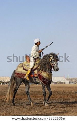 RABAT, MOROCCO - JULY 30: Local riders participate in a traditional fantasia event (or MOUSSEM in Arabic) which is mainly a hobby and a sport July 30, 2009 in Rabat, Morocco. - stock photo