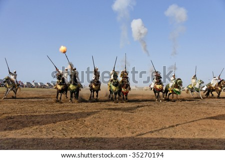 RABAT, MOROCCO - JULY 30: Local riders participate in a traditional fantasia event (or MOUSSEM in Arabic) which is mainly a hobby and sport event July 30, 2009 in Rabat, Morocco. - stock photo